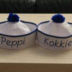 Peppi en Kokkie op aangeleverde mutsjes geborduurd